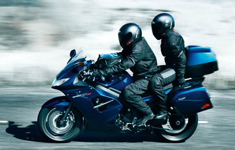 pillion passenger on motorbike
